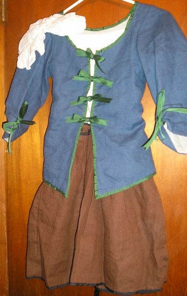 girl's cap, juste-au-corps or jacket and skirt or jupe with ferreted hem